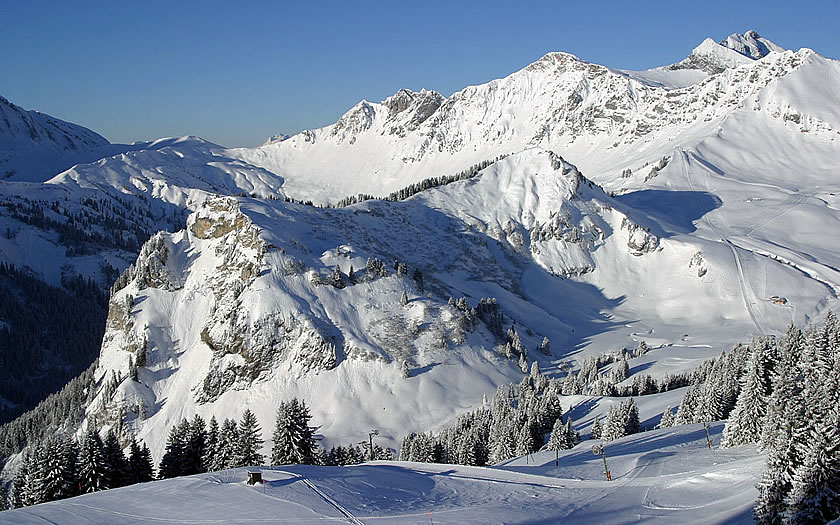View across the Les Crosets ski area in Switzerland to the Chavanette black run.