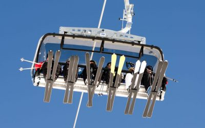 Skiers on a full chairlift
