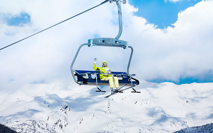 Single skier on a chairlift